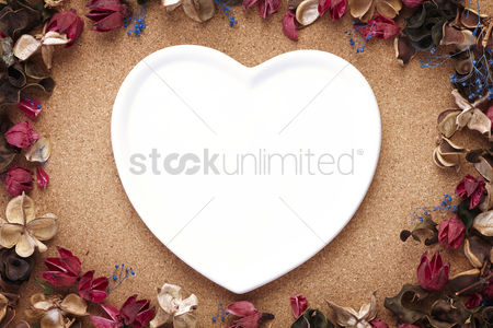 Conceptual : Heart shaped plate with dried flowers