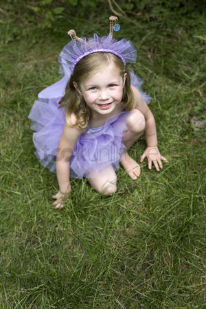 Gladness : High angle view of little girl wearing ballet dress