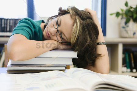 High school : High school student sleeping in library