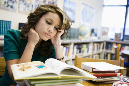 School : High school student studying in library