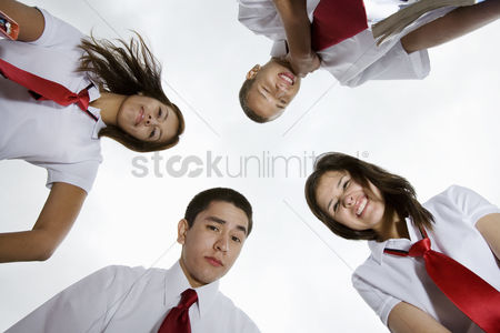 Posed : High school students looking down