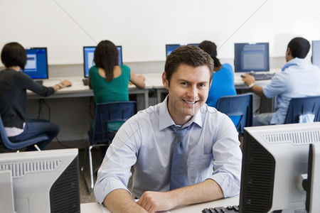 Posed : High school teacher in computer lab