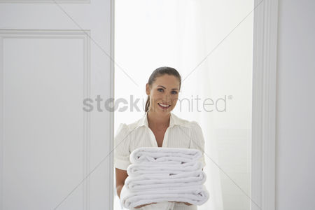 Posed : Housekeeper bringing towels