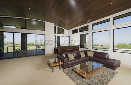 Furniture : Interior with furniture and large windows with outside views