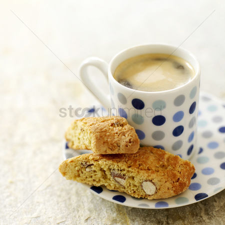 Refreshment : Italian espresso in spotty blue cup with cantuccini biscuits