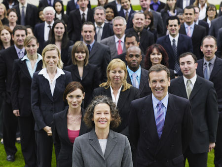 Leadership : Large group of business people standing on lawn portrait elevated view