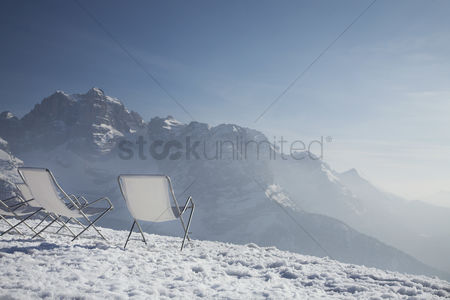 Winter : Lawn chairs on mountain peak