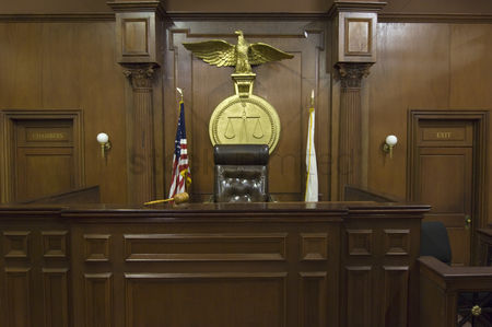 Flag : Legal scales behind judges chair in court