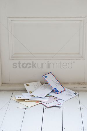 Interior : Letters on floorboards at front door