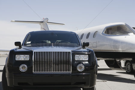 Transportation : Limousine and private jet on landing strip