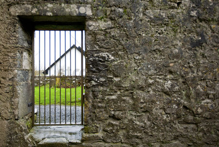 Grass background : Locked gate in old stone wall