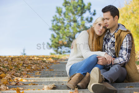 Steps : Loving couple sitting on park steps