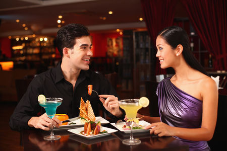 Satisfaction : Man and woman chatting while having dinner together