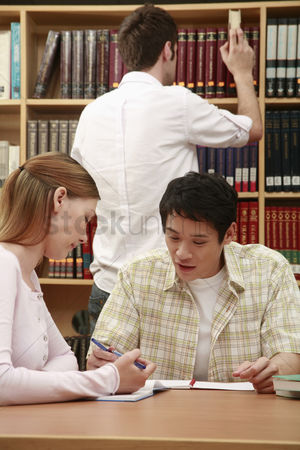 Eastern european ethnicity : Man and woman having discussion in the library