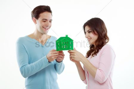 Girlfriend : Man and woman holding a green house