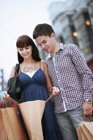 Spending money : Man and woman looking into shopping bag