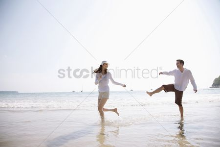 Girlfriend : Man and woman playing on beach