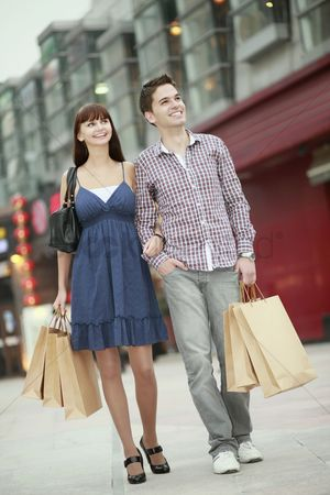 Spending money : Man and woman with shopping bags