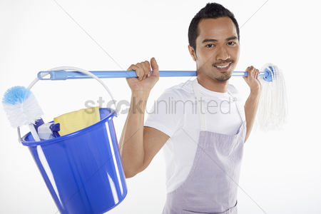 Masculinity : Man carrying mop and bucket on his back