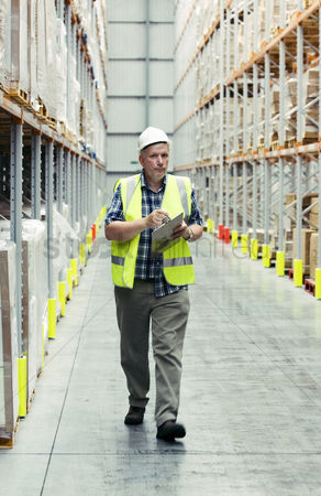 Supervisor : Man checking warehouse goods
