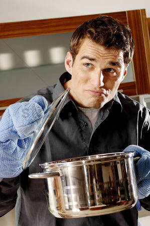Wondering : Man cooking in the kitchen