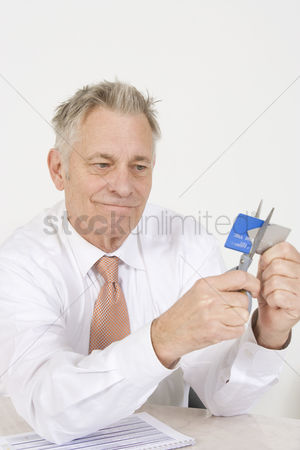 Mad : Man cutting up credit card