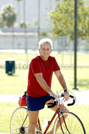 Strong : Man cycling in the park