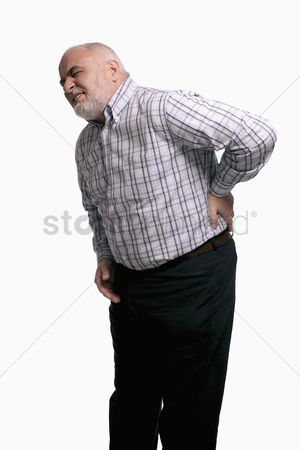 Frowning : Man having a backache