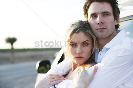 Car : Man hugging his girlfriend from behind