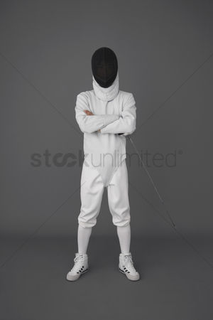 Fight : Man in fencing suit posing for the camera