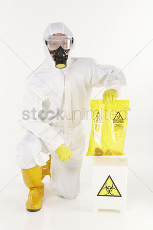 Masculinity : Man in protective suit disposing biohazard waste