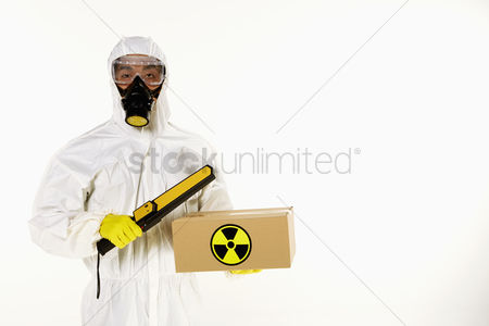Masculinity : Man in protective suit inspecting a radioactive box