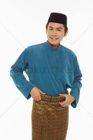 Traditional clothing : Man in traditional clothing adjusting his sarong