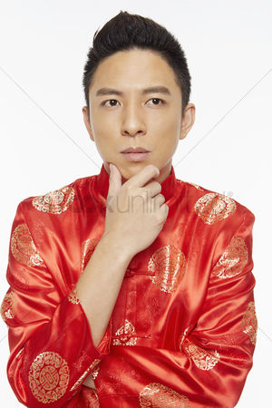 Lunar new year : Man in traditional clothing contemplating