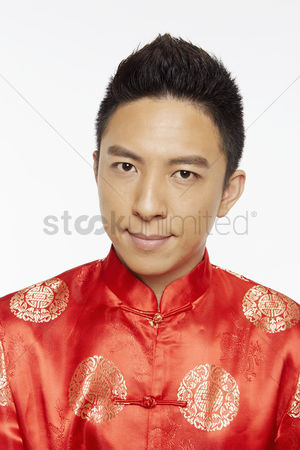 Lunar new year : Man in traditional clothing looking at the camera