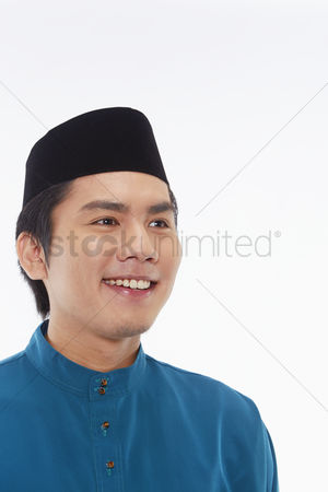 Baju melayu : Man in traditional clothing smiling