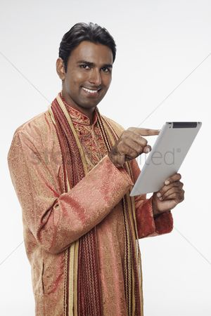 Portability : Man in traditional clothing using digital tablet