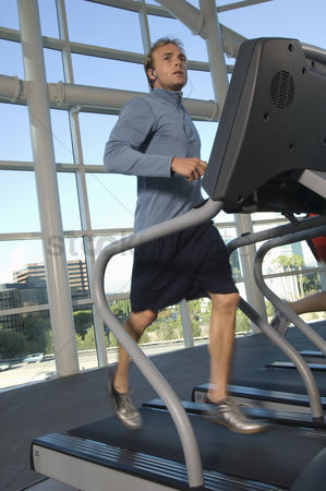 Workout : Man jogging on treadmill at gym