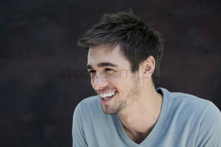 Cheerful : Man laughing while looking away