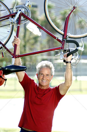 Strong : Man lifting up bicycle