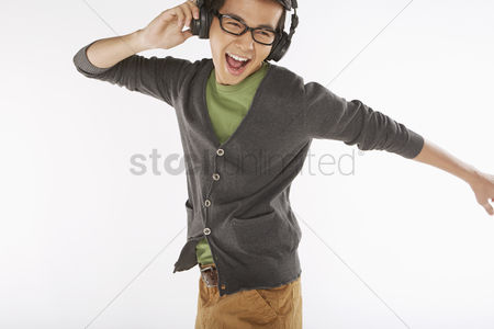 Dancing : Man listening to music on the headphone