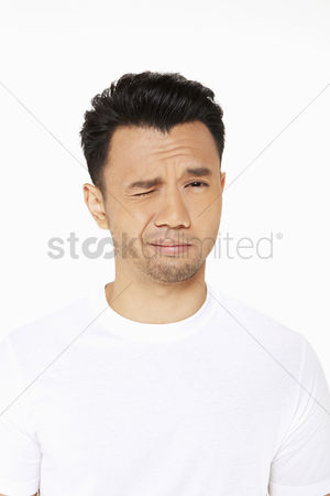 Frowning : Man looking confused