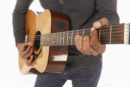 Masculinity : Man playing with a guitar
