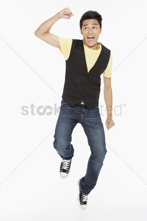 Masculinity : Man posing while jumping mid air