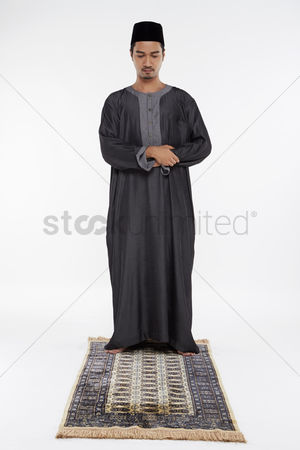 Religion : Man putting his right hand on top of the left hand  placing it against his chest
