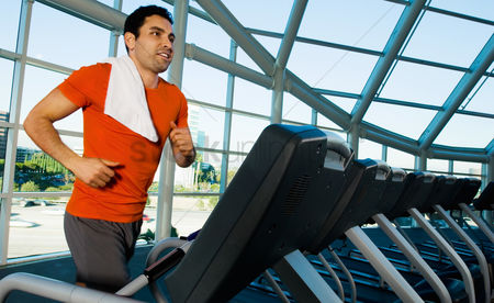 Fitness : Man running on treadmill in gymnasium
