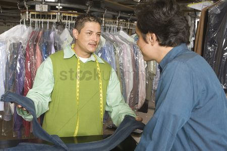 Advice : Man serving customer in the laundrette