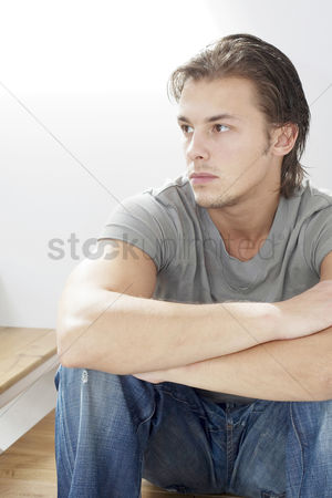 Stairs : Man sitting on the staircase thinking