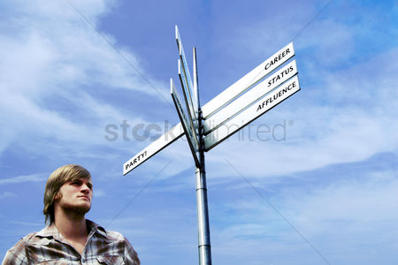 Selection : Man standing under a signboard