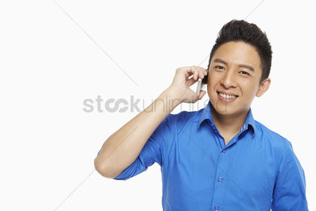 Malaysian chinese : Man talking on his mobile phone